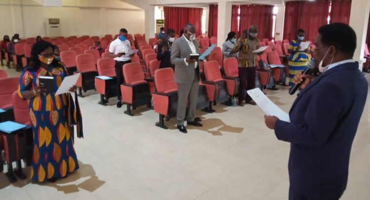 Prof. Yankah swearing in members of the council